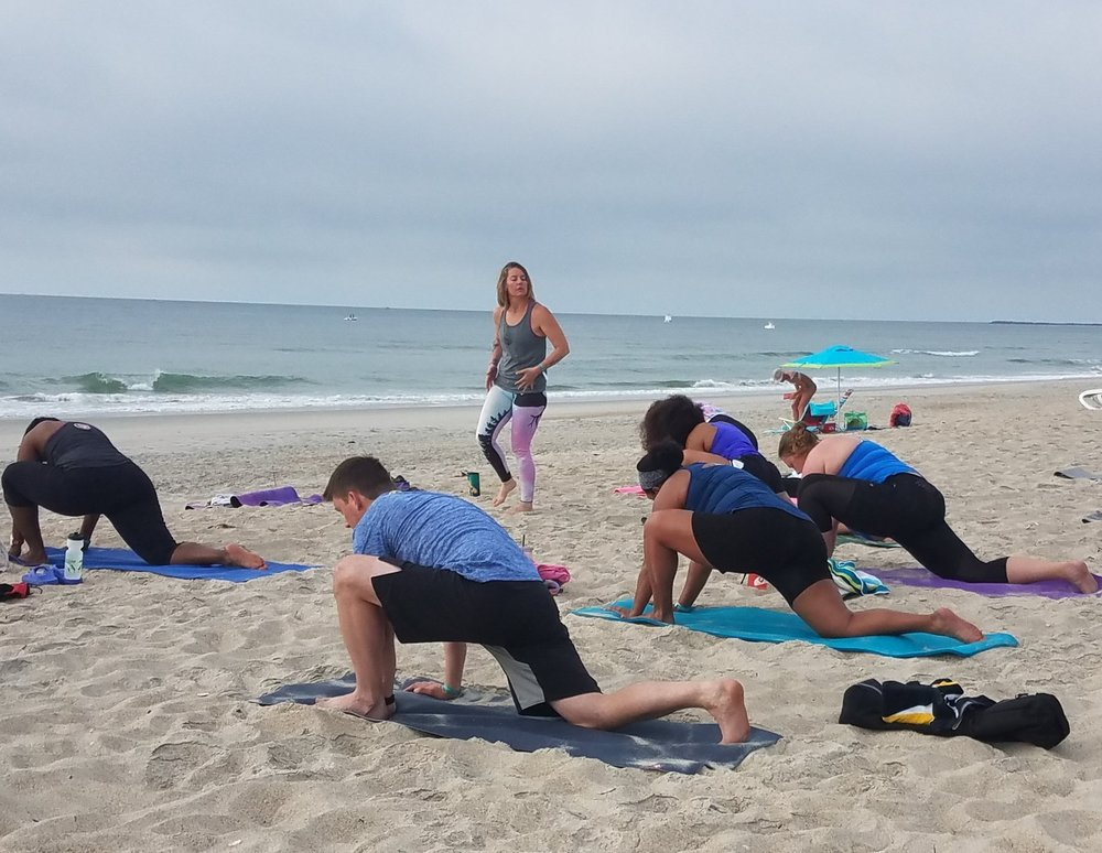 H2Om Yoga on the beach at the 2017 WaveOne Open Water Camp.