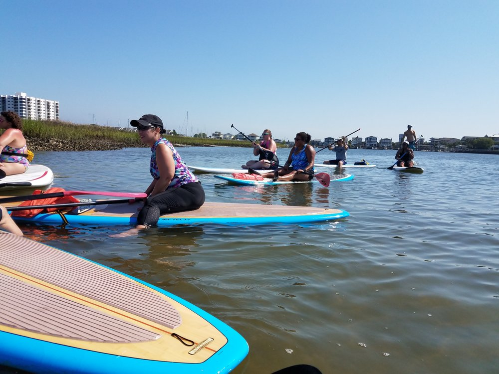 Learning about currents and tide affect during the SUP lesson from Jason at Carolina Paddleboards.