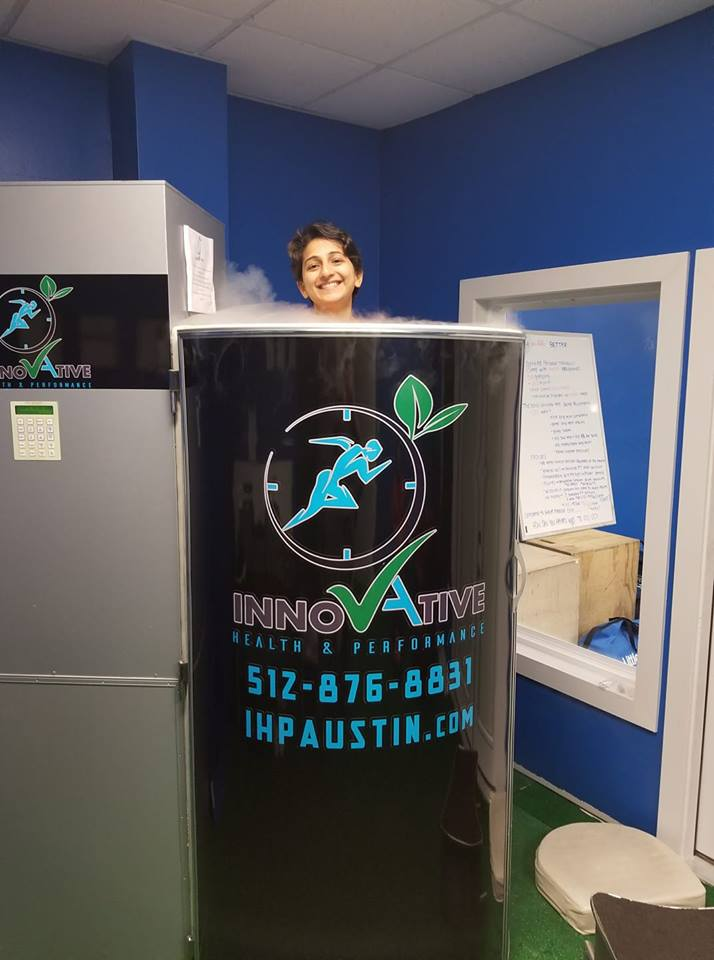 Person in Innovate Health and Performance cryotherapy chamber