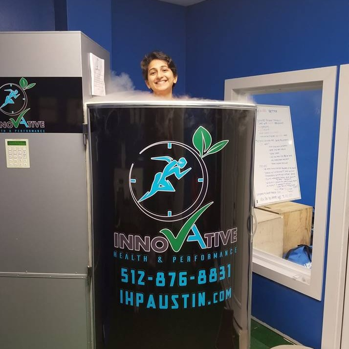 Person in cryotherapy chamber at Innovative Health and Performance