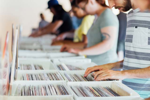 people-sifting-thru-records.jpg