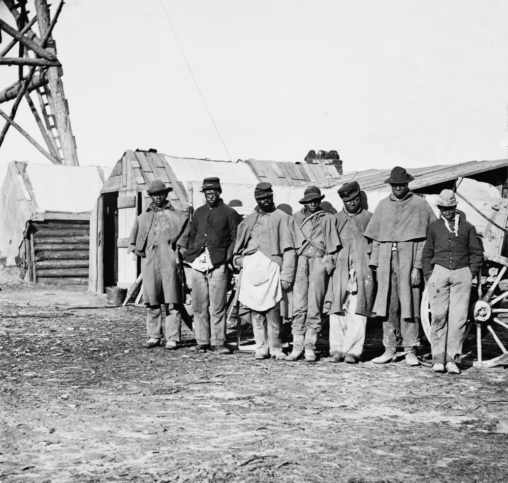 African-American contrabands dressed in old Union uniforms worked as teamsters, managing the mule and horse pulled wagons for the Union Army of the James 1864-65.jpg