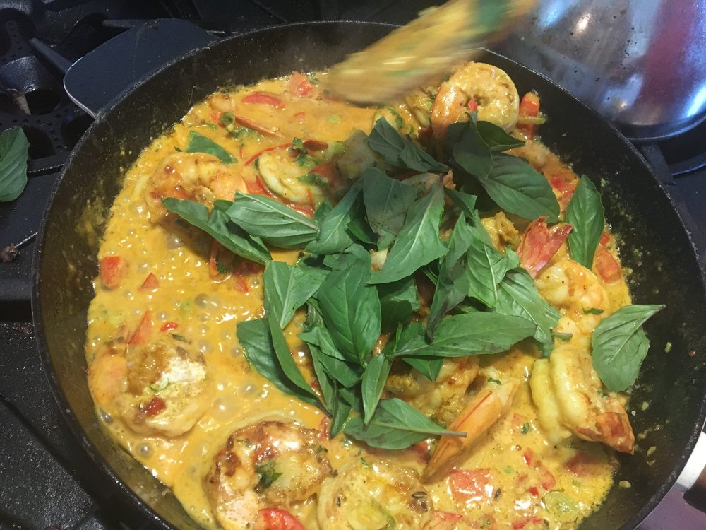 Cook for two to three minutes, add torn basil leaves. -