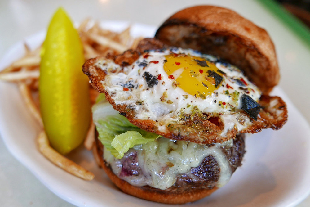 The Lil Frankies Hamburger with Fontina Cheese, Lettuce and Tomato and a Crispy Egg on Top French Fried
