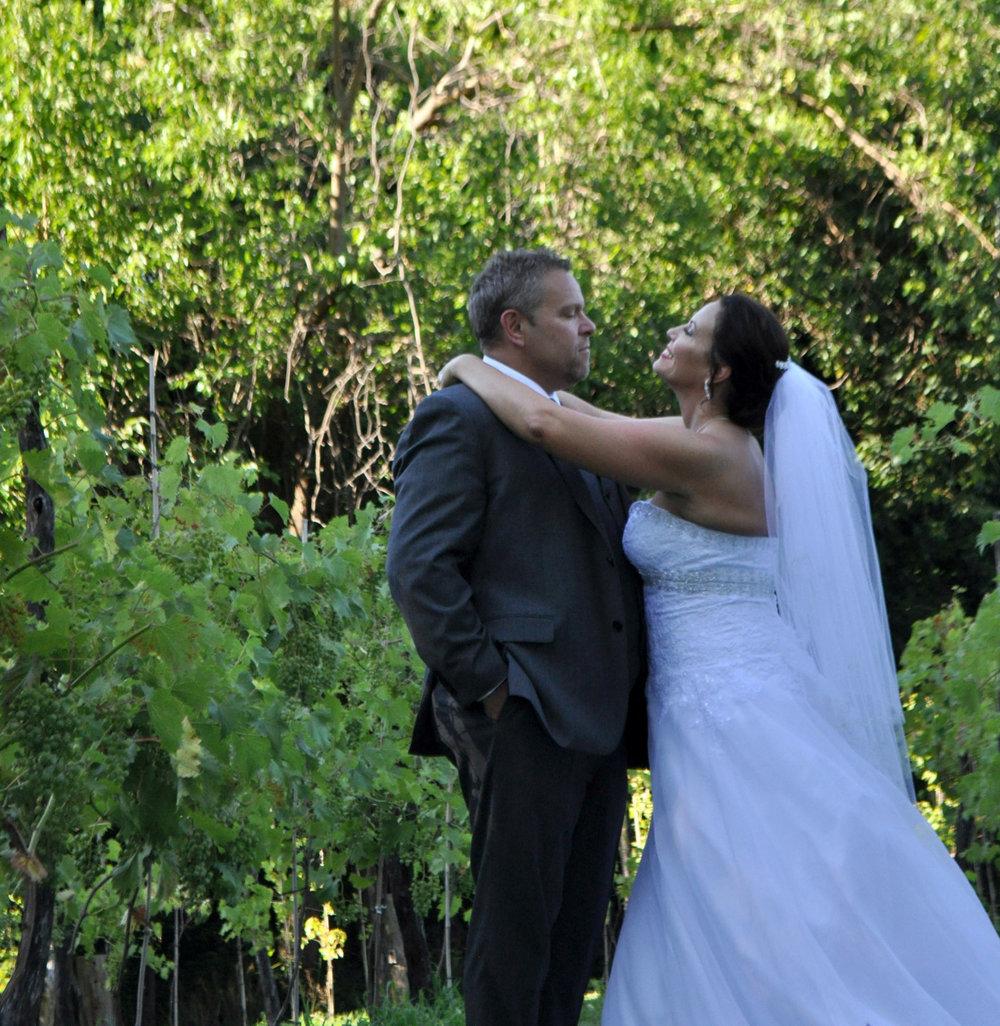 bride and groom at mallinson vineyard and hall at sugar creek mo.jpg
