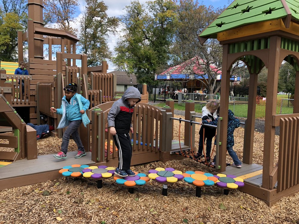 Phase 1 of playground is open - In mid-September, The Friends of Stewart Park, a local nonprofit committed to revitalizing Stewart Park, held a Community Build of the area's first Accessible Playground. For a period of six days, twelve hours a day, and in three shifts a day, over 1,000 volunteers and 45 organizations worked alongside playground design firm Play by Design to create the pre-school sections of a new playground for children of all abilities. This beautifully-designed inclusive playground will dramatically enhance Stewart Park as a regional destination for families, individuals, children of all ages, and visitors. Learn More.