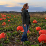 Alison Perry self portrait in North Fork Pumpkins