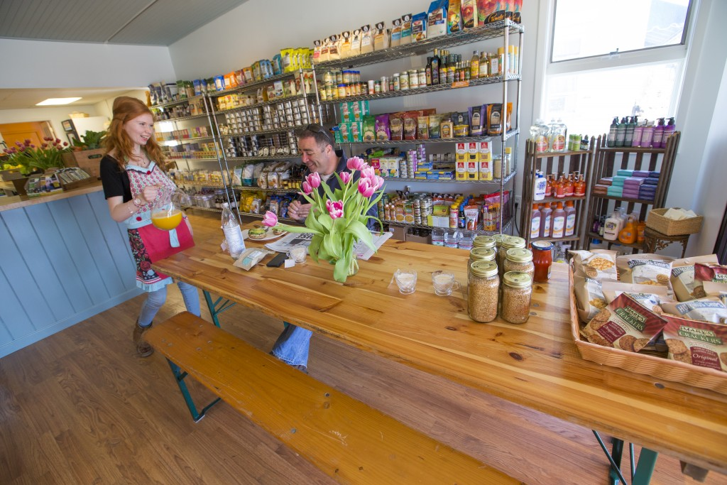 Rowan Hausman of Mattituck, a juicer at The Giving Room  Health Food and Juice Bar in Southold brings over freshed pressed juice over to  Ross Moran of Jamesport who made a stop over for lunch on Wednesday, April 23, 2014. The Giving Room organic juice bar and health food shop in Southold offers juices, smoothies, organic foods and products. By Randee Daddona