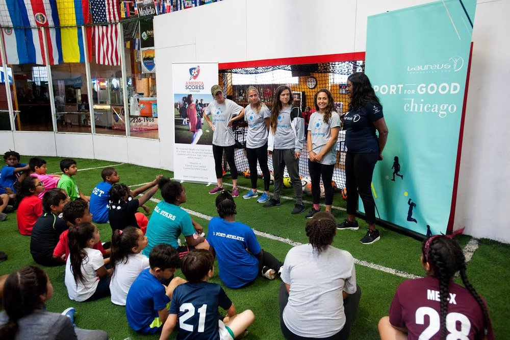 Arin Gilliland, Alyssa Mautz, Danielle Colaprico with Laureus CEO Benita Fitzgerald Mosley during a Q & A with America SCORES campers.