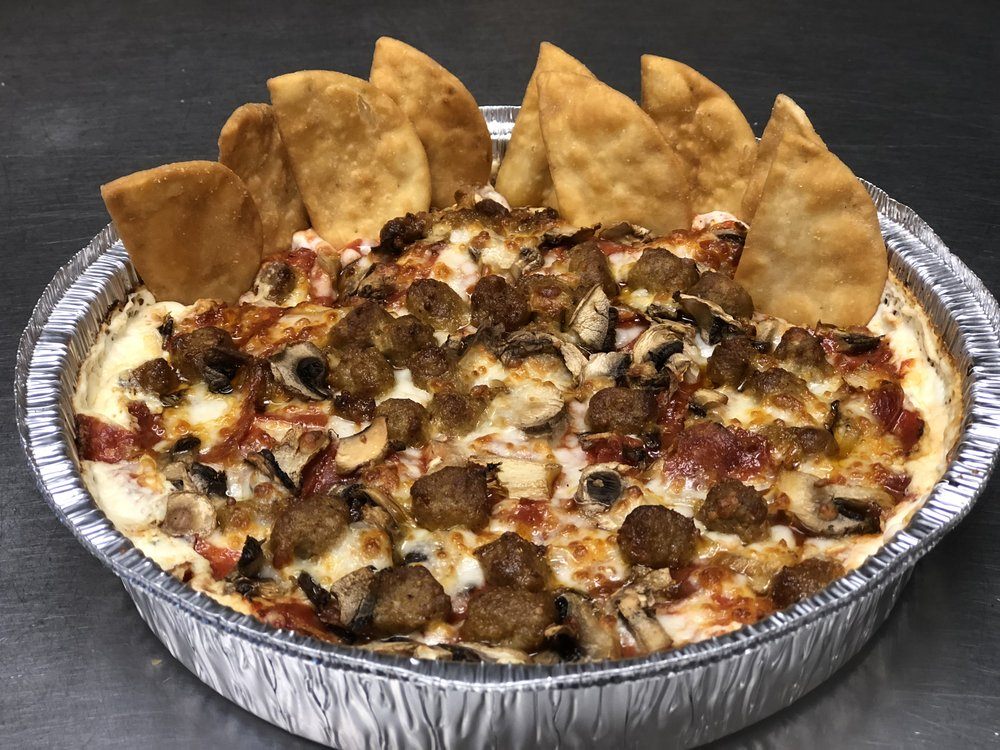 PIPER'S SECRET PIZZA DIP   Our secret Pizza Dip includes a cheesy, slightly spicy base, covered with our own, house-made marinara and mozzarella cheese with your choice of one topping. Served with pita chips.   Small: 8.99 Large: 11.99    Add extra items: 1.25 each