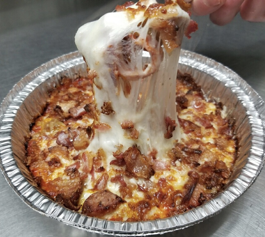 """Crust-less Keto Pizza   Not a fan of carbs? We can help you there!  Piper's is happy to introduce our new crust-less Keto pizza. Served in a 7"""" round tin, we use our house-made sauce, high quality mozzarella and 3 of your favorite toppings for no extra charge.  6.99   Add even more for only  .50 per item."""