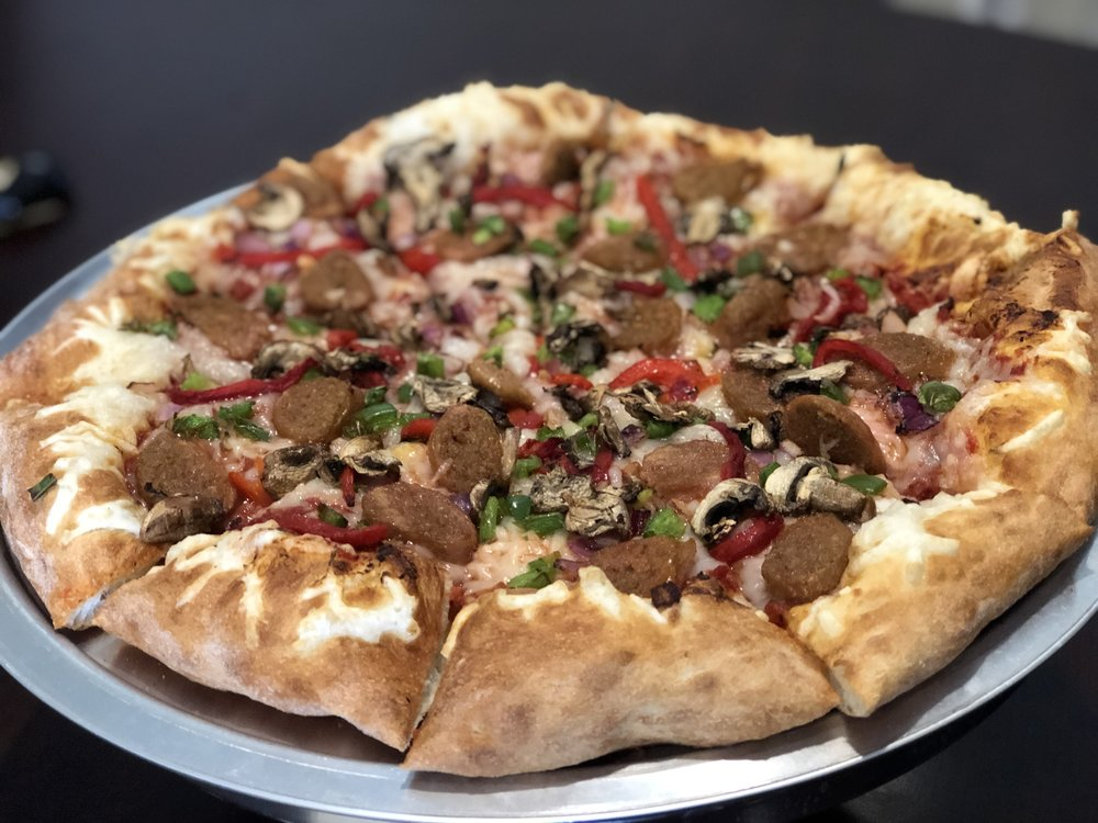 The Beyond-Vegan Pizza   This delicious pizza uses our amazing house-made dough and sauce to deliver the great flavors of our vegan cheese, Beyond-vegan sausage, onions, green peppers, roasted red peppers, tomatoes and mushrooms to make a hearty pizza that even a meat lover would enjoy!  Try it on our Gluten-free or cauliflower crusts!   Small Medium Large X-Large    24.74 27.99 30.94 33.25