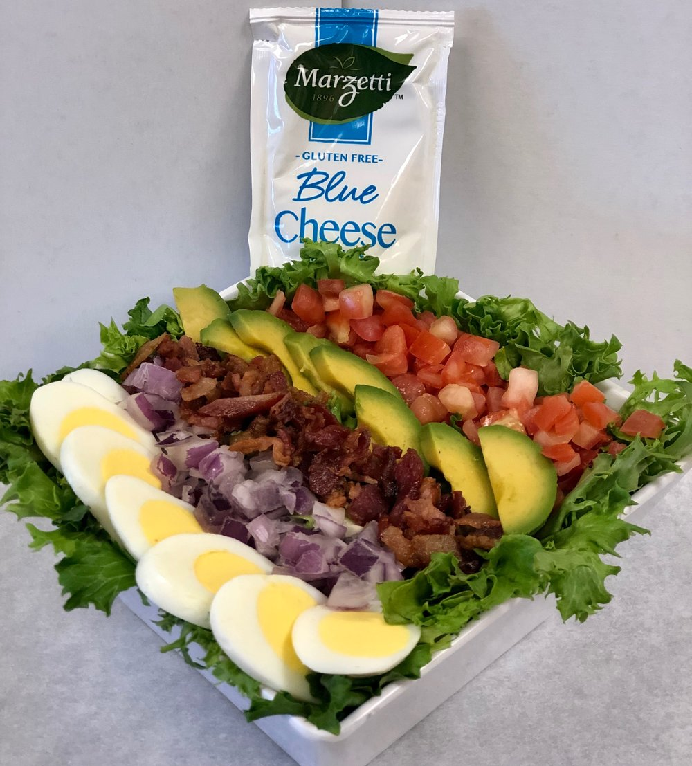Piper's Cobb Salad   Protein-packed, mixed greens, topped with hard-boiled eggs, bacon, avocado, onions and tomatoes. Served with blue cheese dressing.   Small: 8.99 Large: 10.99