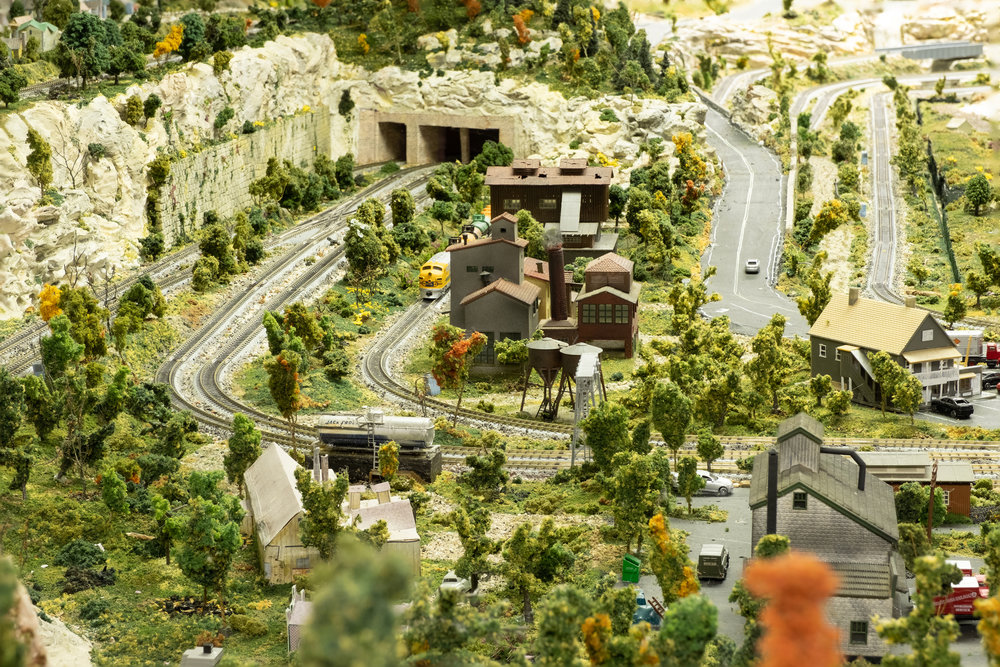 Looking past the edge of town to the cliffs along the west side of the layout.
