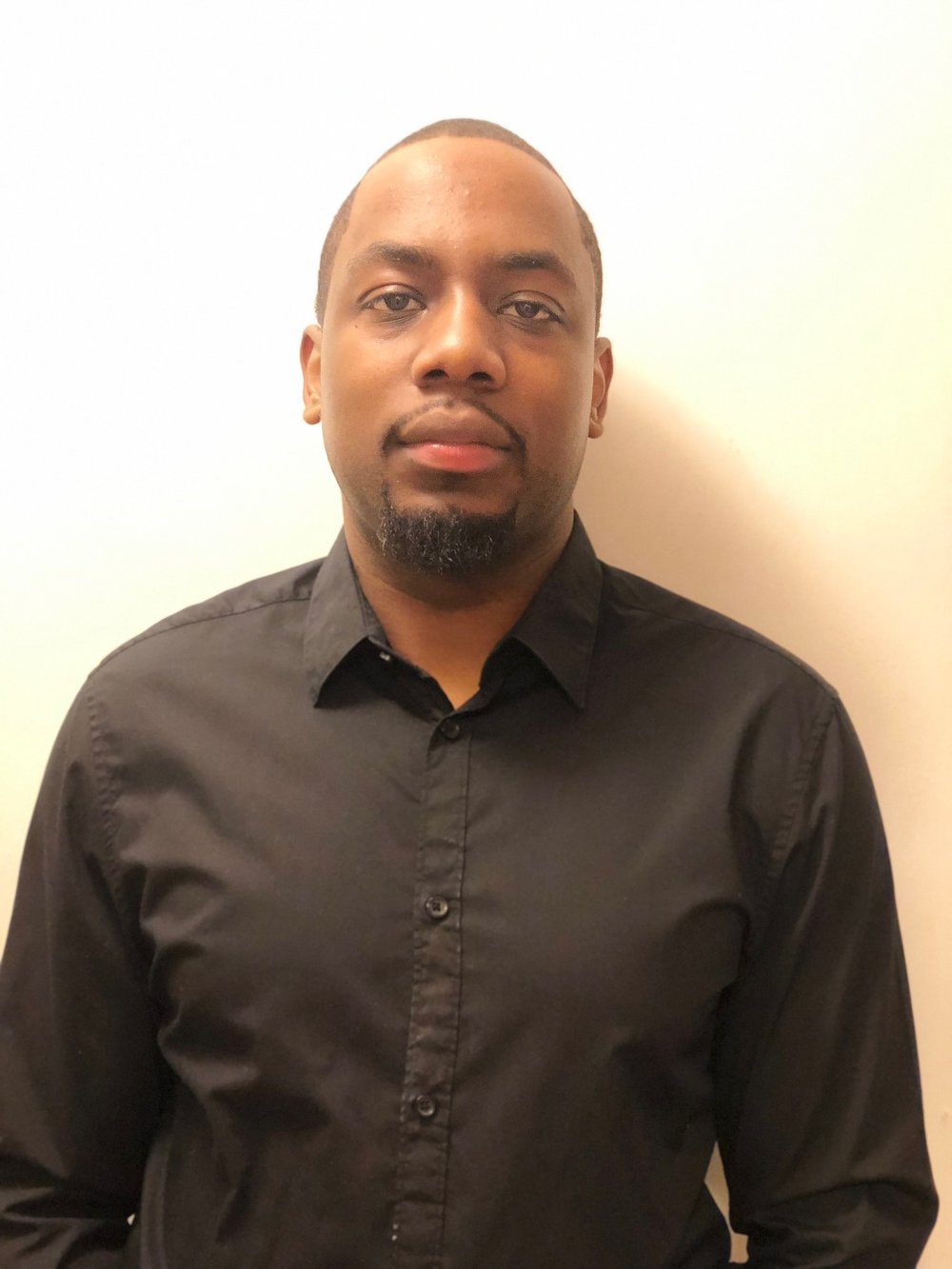 Travis Simms  Associate Degree in Communications from Kingsborough Community College, Correction Officer for New York City Department of Corrections