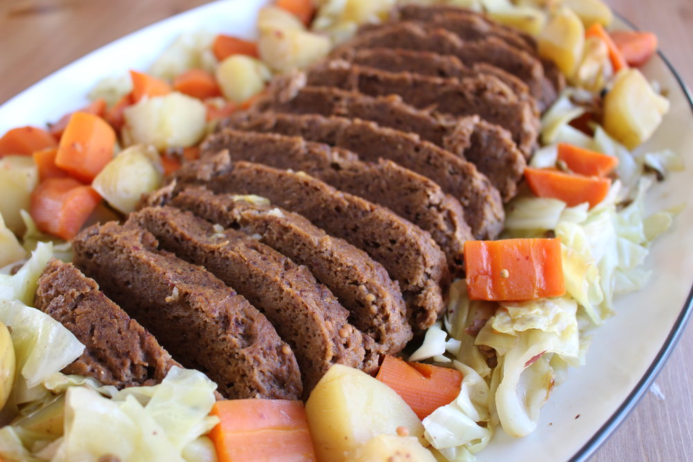 Seitan corned beef stewed with cabbage, carrots and potatoes for St. Patrick's Day.