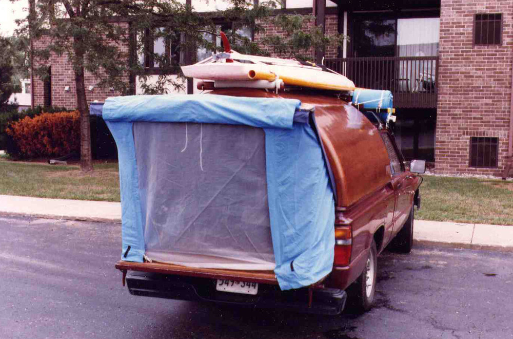 The door was hung on a single giant Soss hinge and locked open with an arm that reached down both sides. The tent snapped on with camping gear clips