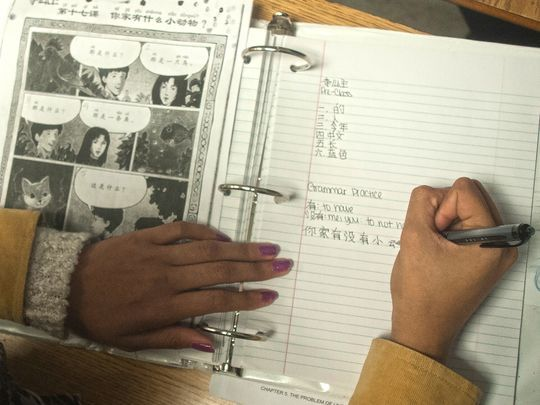Student Tyasia Albert writes vocabulary words during Mandarin Chinese class at Brimm Medical Arts High School in Camden. (Photo: Jose F. Moreno/Staff Photographer)