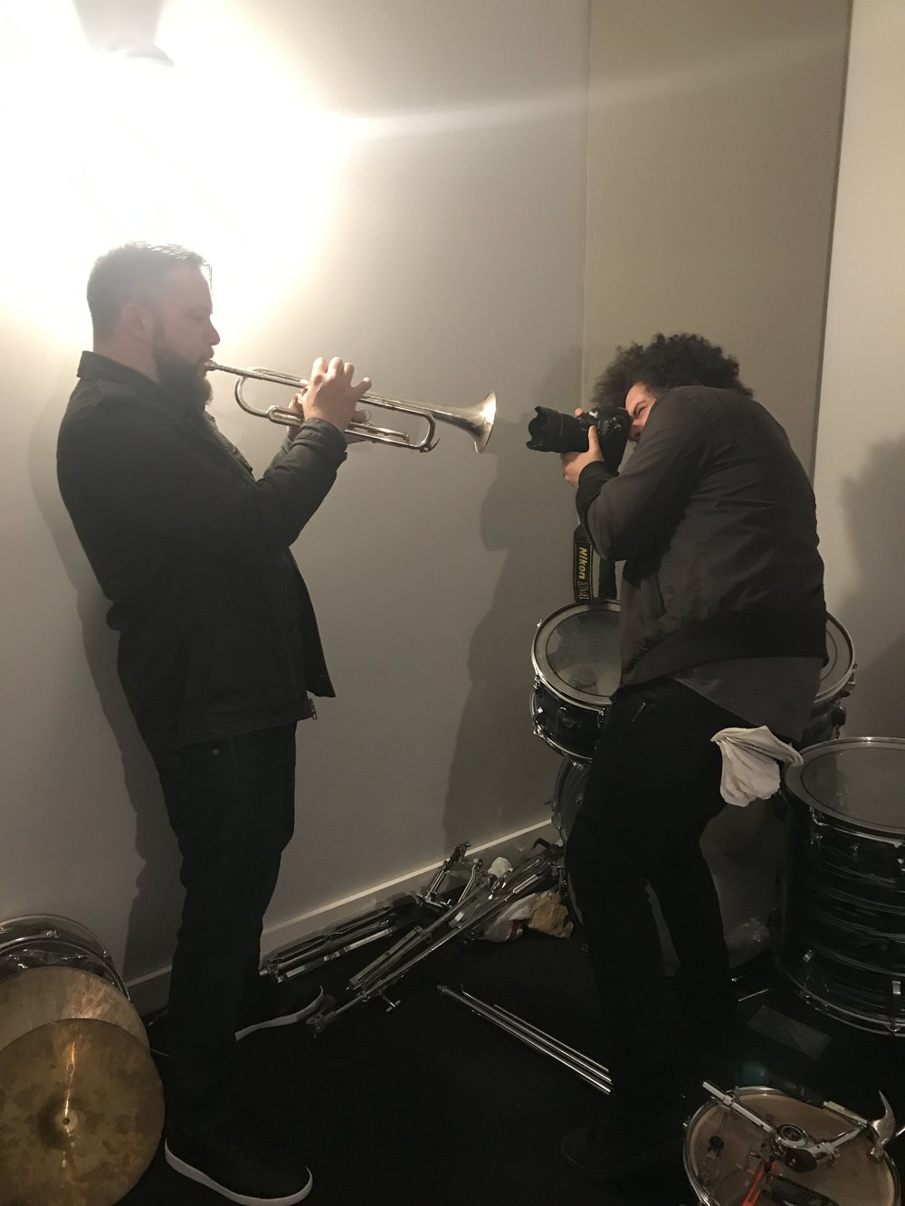 Matt Cappy (left) plays trumpet in a rehearsal room at The Gradwell House in Haddon Heights while being photographed by Courier-Post photographer Joe Lamberti. (Photo: Carly Q. Romalino)