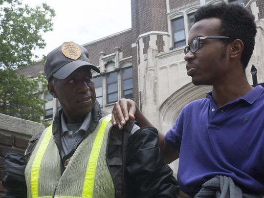 Camden High Student Devine Bowens talks to security guard Terry Pace outside the school, known as the Castle on the Hill. (Photo: Jose F. Moreno/Staff Photographer)