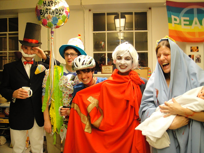 """Costumes, from Left to Right: Monopoly Man, A Birthday Party, An Embarassed """"Cyclist"""", A White Russian, and A Bloody Mary"""