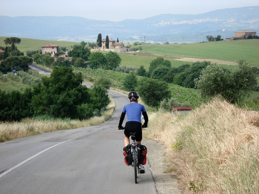 Renee cycling on a bike tour in Italy.
