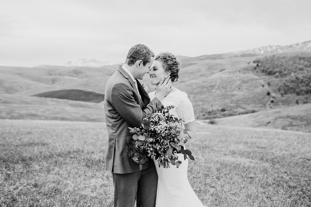 black and white formals wedding photos bride and groom holding hands paradise utah professional photographer