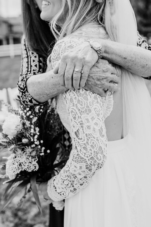 wedding day grandma's hug park city family reception photographer calli richards black and white wedding photos