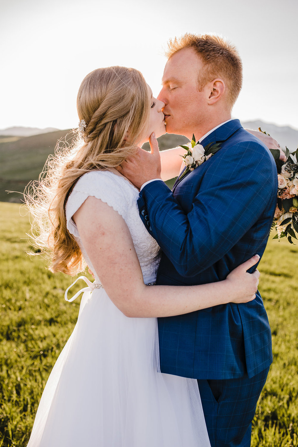northern utah wedding photographer calli richards navy blue suit bride and groom wedding dress flowing lace short sleeves modest lds wedding dress northern utah couple