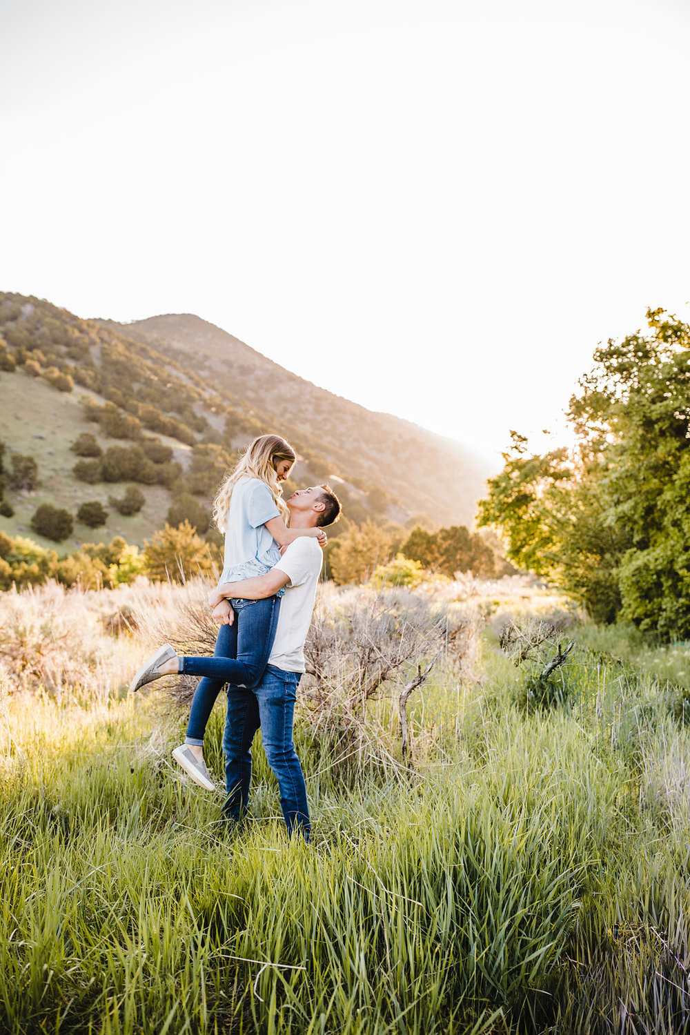 best engagement photographer logan utah professional couples photography mountains field of flowers
