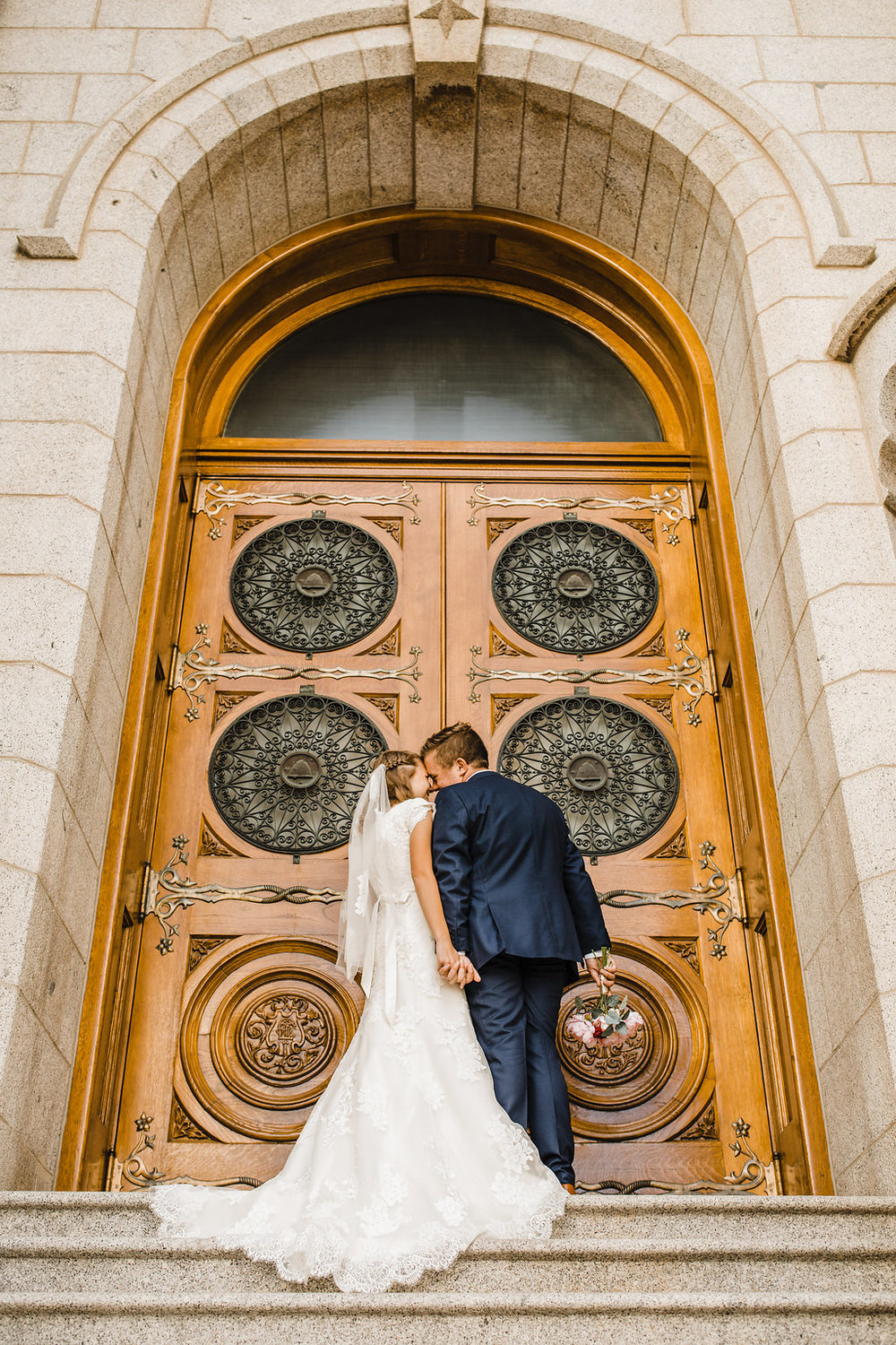 young lds couple outside the salt lake city lds temple northern utah wedding photographer