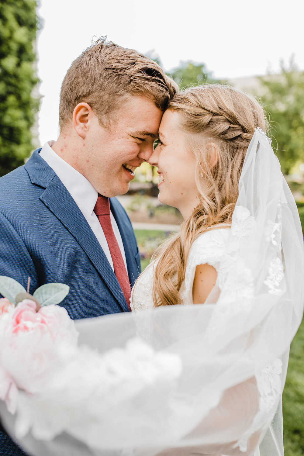 salt lake city wedding photographer i love wedding veils bright lighting young lds couple temple grounds utah