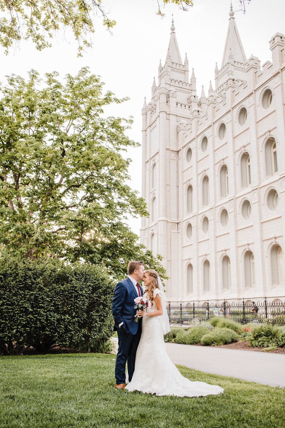 professional wedding photographer in salt lake city utah photo shoot on the lds temple grounds in northern utah calli richards