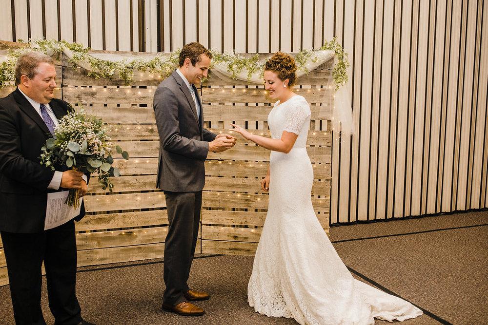 bride and groom vow exchange professional wedding photographer indoor wedding reception ring ceremony