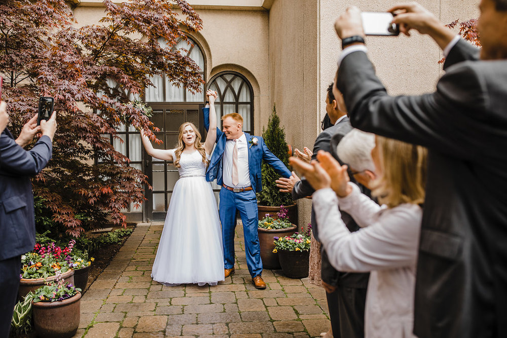 logan utah wedding day photographer temple exit lds temple cache valley bride and groom navy suit lds couples