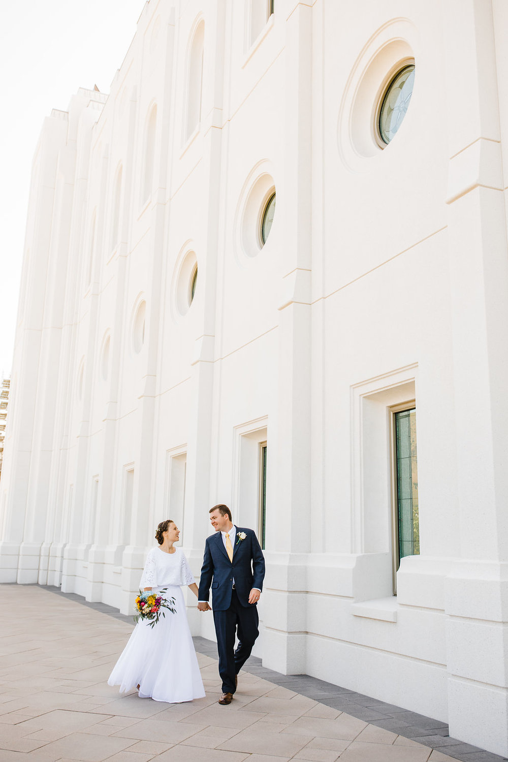 beautiful shot of the brigham city lds temple bride and groom on their wedding day calli richards professional wedding photographer