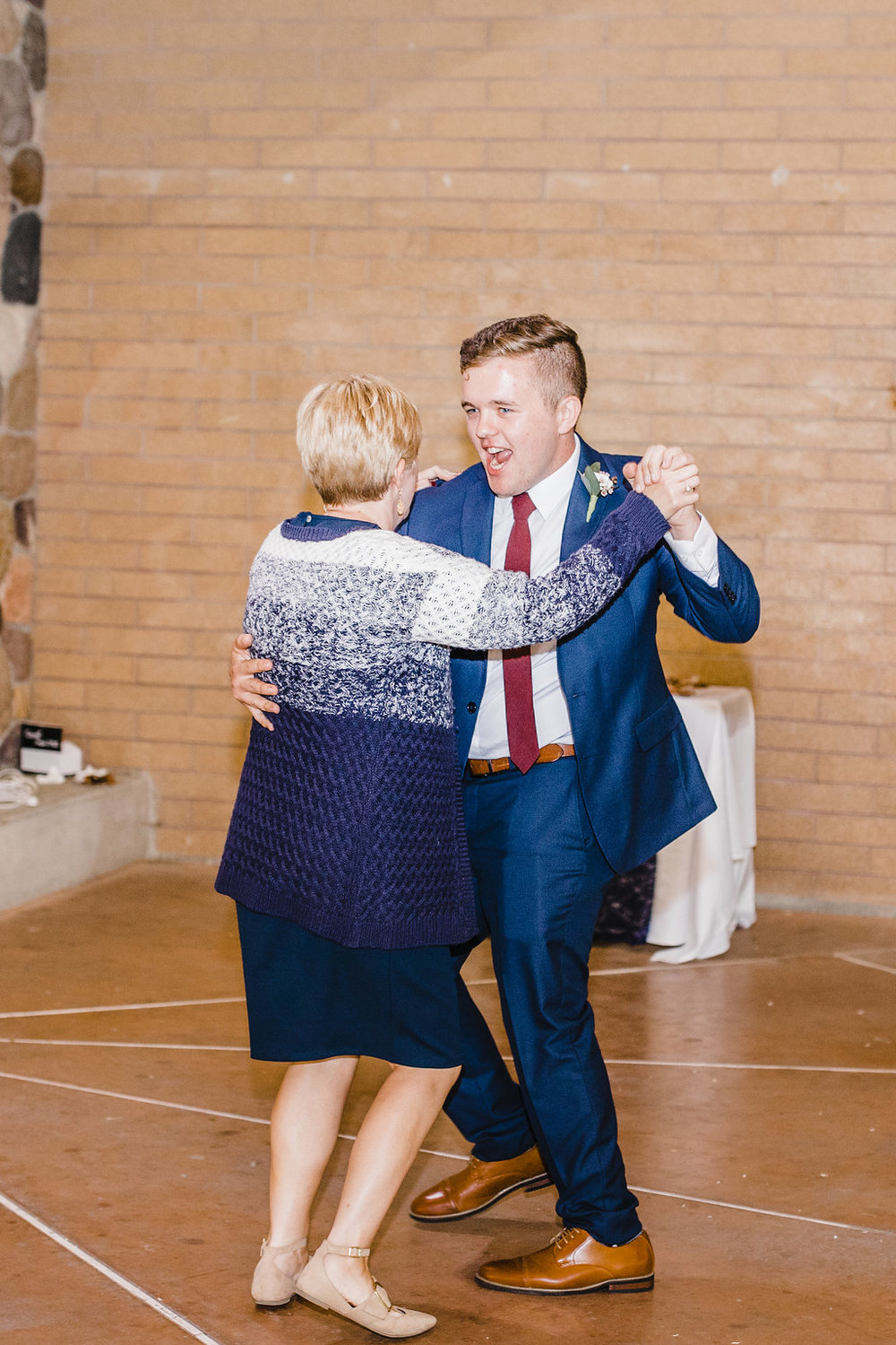 groom and mother dance at lds wedding reception in salt lake city utah professional wedding day photographer reception photography