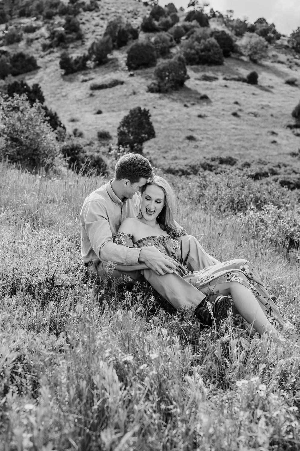 black and white engagement photography wildflowers