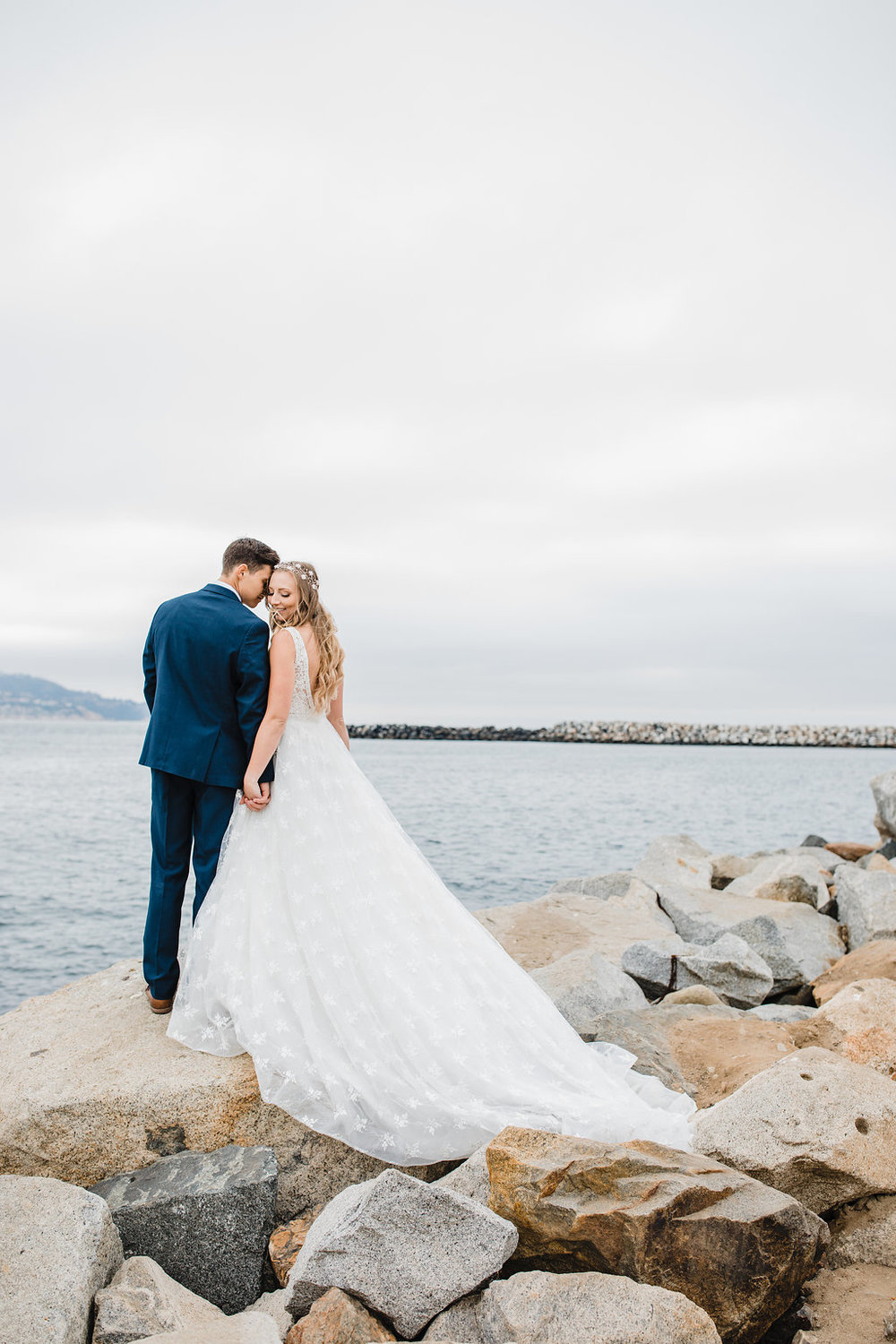 bride and groom by the water los angeles california professional wedding day photography wedding dress train