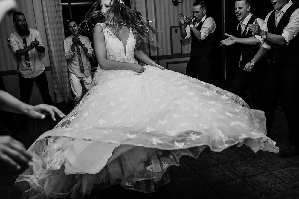 bride dancing at los angeles wedding reception black and white professional wedding day photography