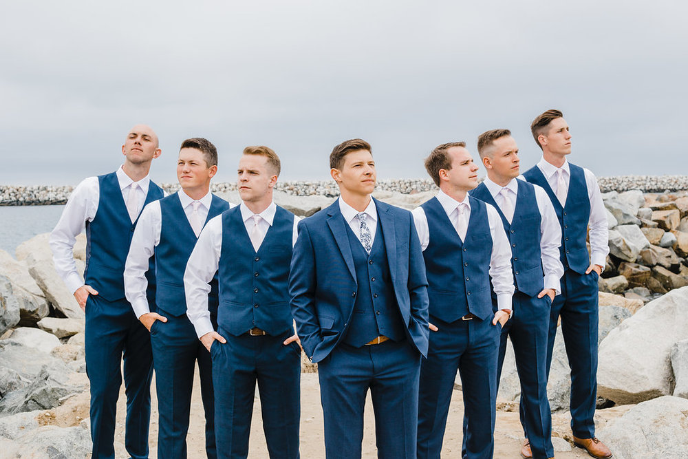 groom and groomsmen pose navy blue los angeles professional california wedding day photographer