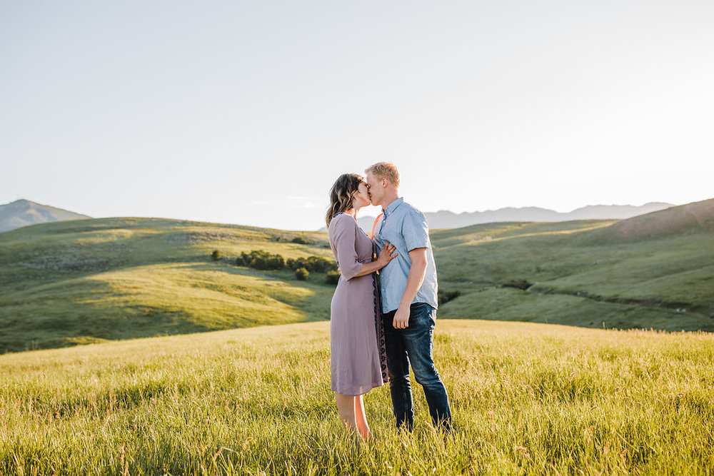 professional engagement photography couple kissing in the hills