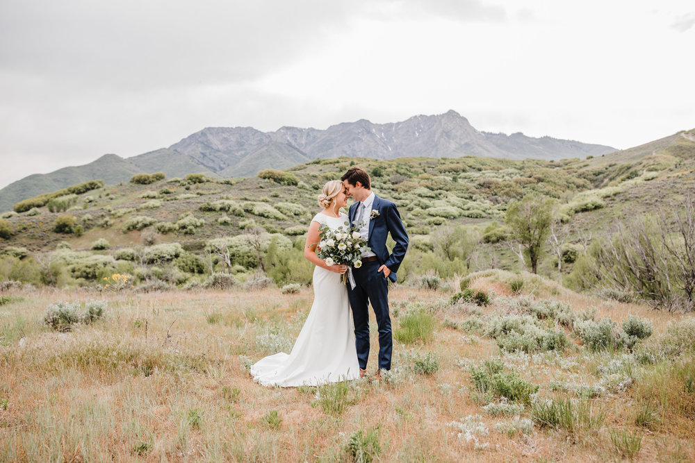 best wedding photographer in westminister colorado bohemian wedding bouquet mountain bridals kissing romance