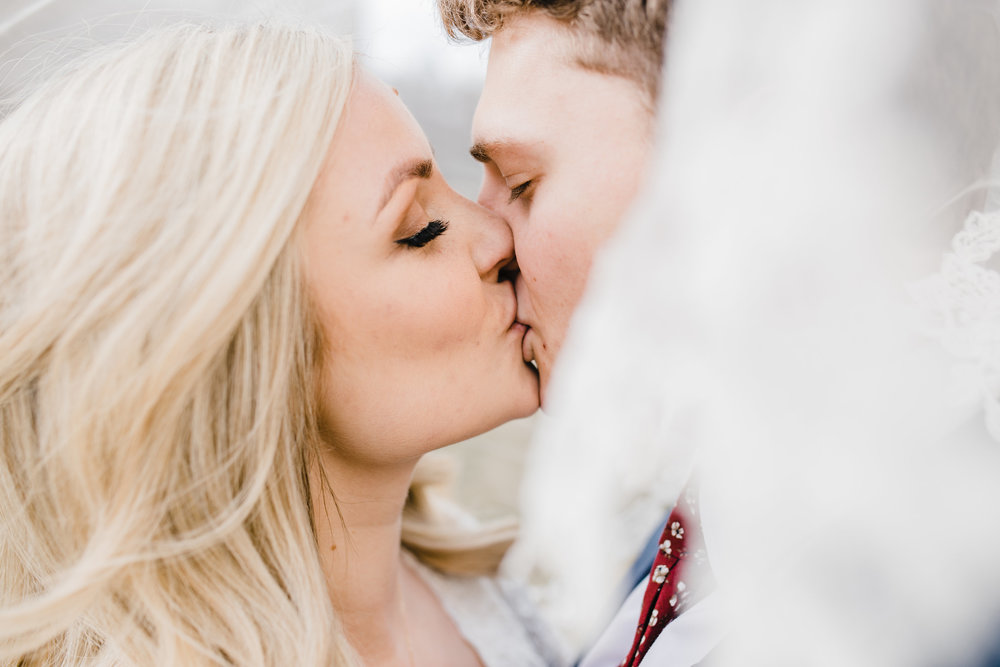 best wedding photographer in park city utah kissing romantic veil picture