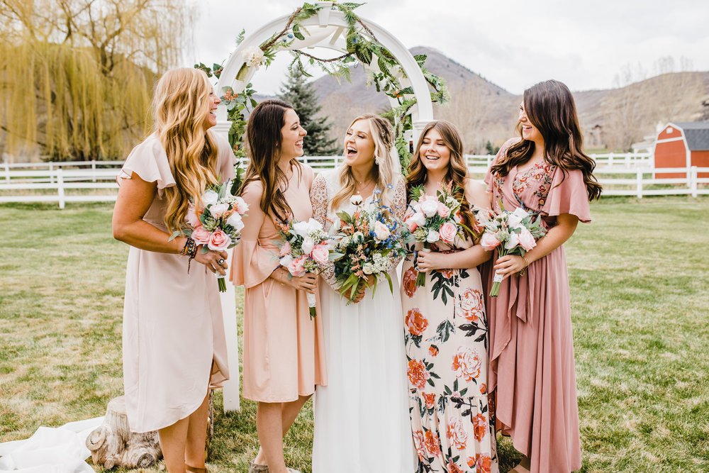 park city wedding photographer mismatched bridesmaids dresses laughing wedding party wedding arch outdoor wedding