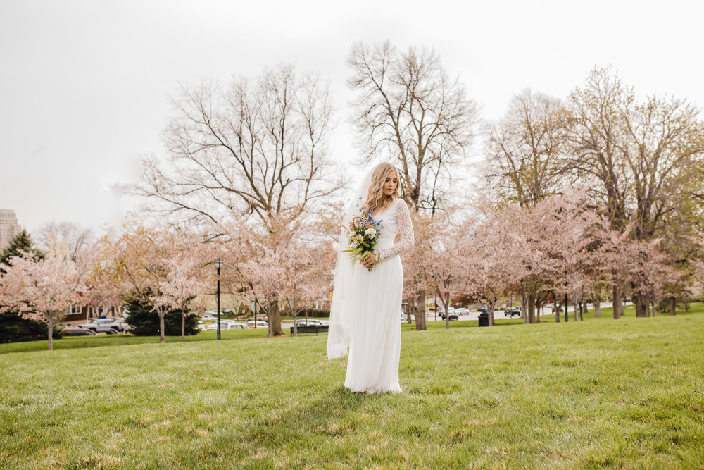 professional wedding photographer in park city utah bohemian flower bouquet spring wedding pink cherry blossoms lace wedding dress