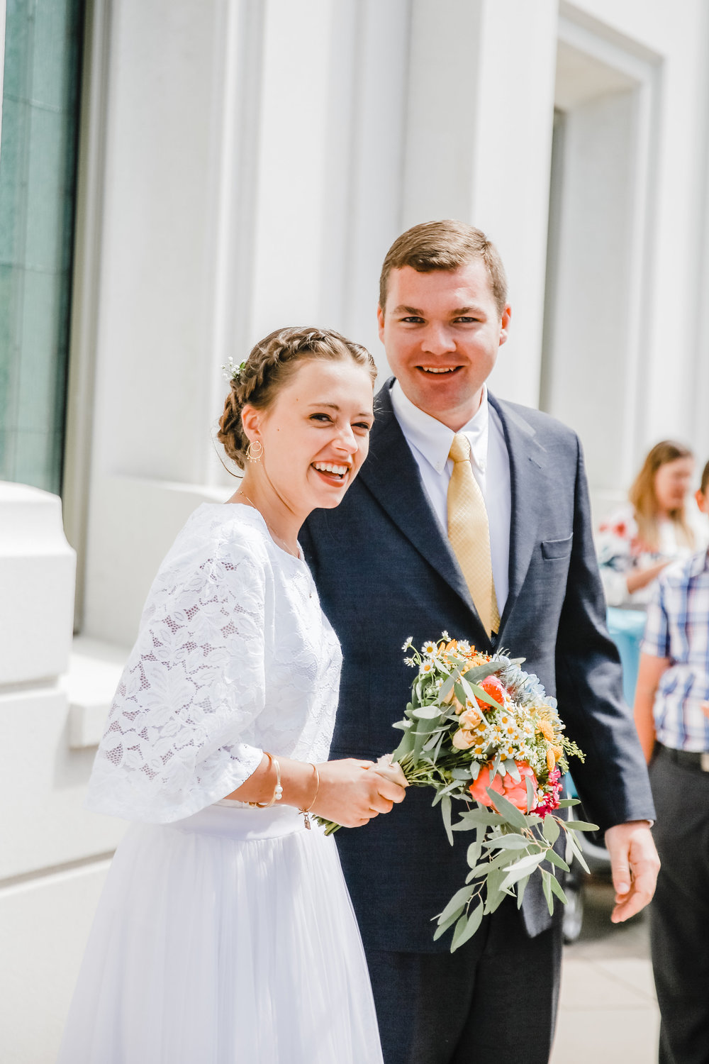 logan utah wedding photographer smiling lds temple weddding lace weddding dress