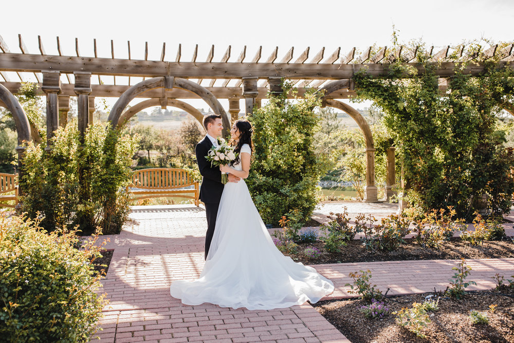 professional wedding photographer in logan utah garden outdoor bridals bride and groom romantic
