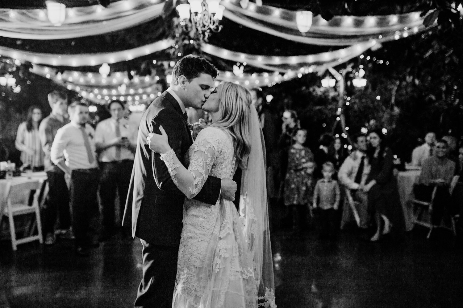 Brigham City Professional Wedding Photographer First Dance Outdoor Kissing