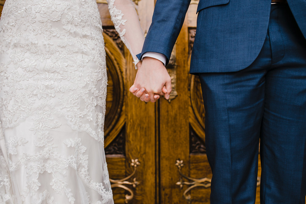 Best professional photographer in lakewood colorado lds temple wedding lace dress holding hands wooden door